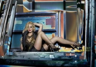 Lindsay-Lohan-Promotes-Stripper-Wear-2-500x352.jpg